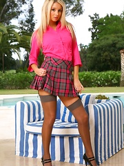 Stevie looks fantastic in her pink blouse and pink tartan miniskirt.