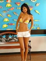 Karla huge breasts barely stay in that tiny bikini top