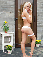 Karina O's beautiful blonde hair and stunning blue eyes accentuates her gorgeous body claid in dainty white lingerie.